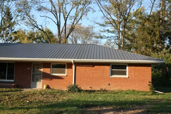 Red brick house with metal roof pictures