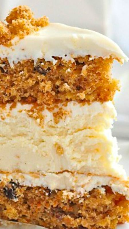 Cheesecake Carrot Cake The Cake Is A Creamy Cheese Cake That Is Sandwiched Between
