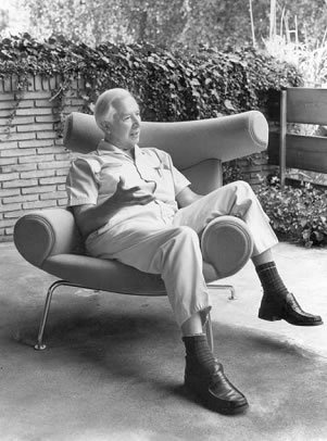 Hans Wegner in his amazing chair!  What a great photo of a great designer.  He is proving that it is comfortable no matter how you sit in it!