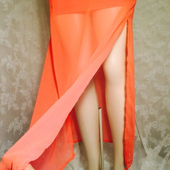 Long coral skirt with brown belt. Long coral skirt with brown belt. It has zipper on the side. 100% Polyester. Sheer overlay  Skirts Maxi