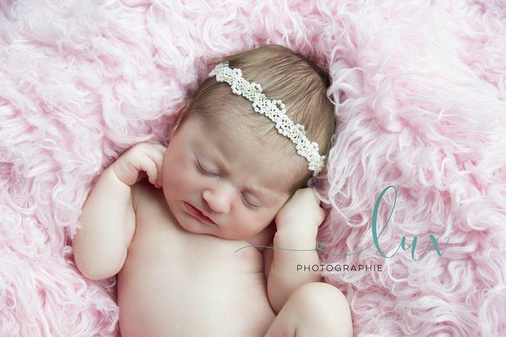 Newborn photography west island newborn baby sleeping on pink fur