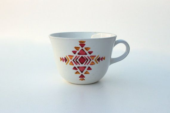 One of a kind handpainted porcelain teacup. Lovely southwestern pattern pairs geometrical design with the charming irregularity of an original freehand painting. This is a functional fine art piece, made to cradle in your hands as you enjoy your favorite brew. The teacup itself is vintage Corelle, approximately 3 tall and 11 around. Handpainted with nontoxic premium quality craft paints using tiny brushes to capture detail, then heat-cured for durability. Top-rack dishwasher and microwave…
