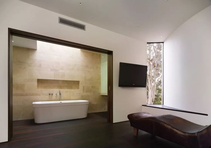 Interior, Modern Minimalist Bathroom Design With Black Laminate Wood Flooring White Wall Interior Color Decorating Ideas Dark Brown Leather Chair Wall Mounted TV And Sliding Door ~ Laminate Wood Flooring