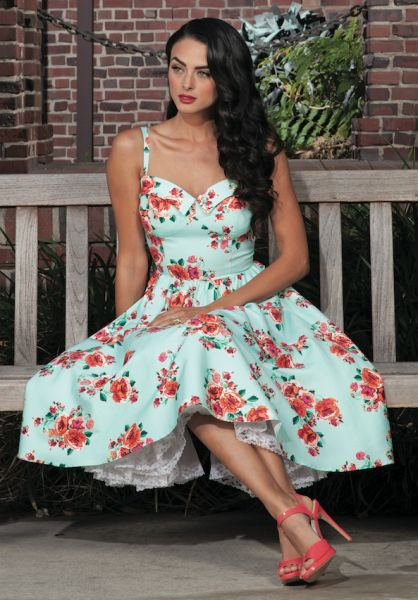 Breathtaking floral dress that flows into a gorgeous full swing skirt. A seasonal must have.