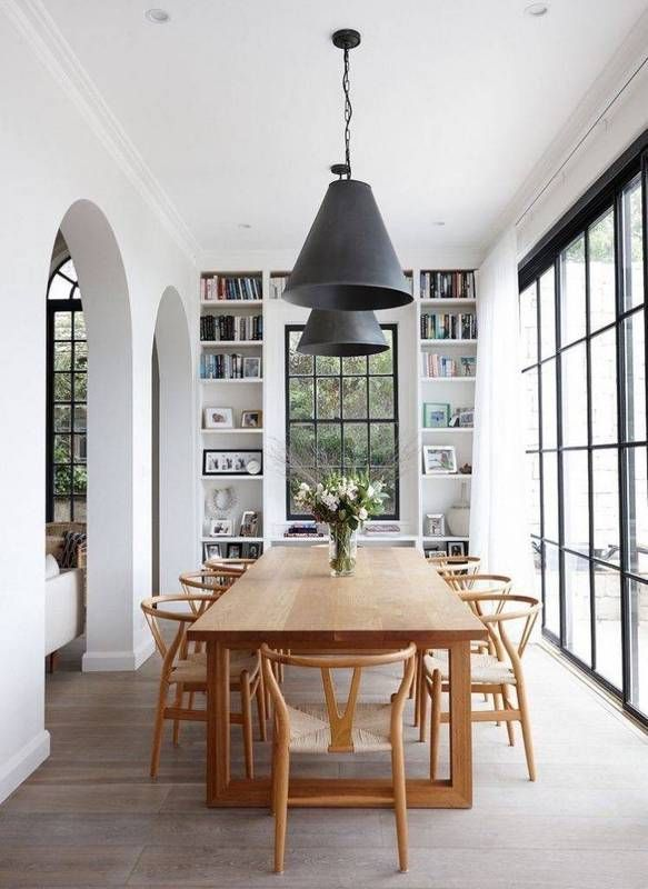 cool Salle à manger - danish interior design white dining room with wood table and black pendant light...