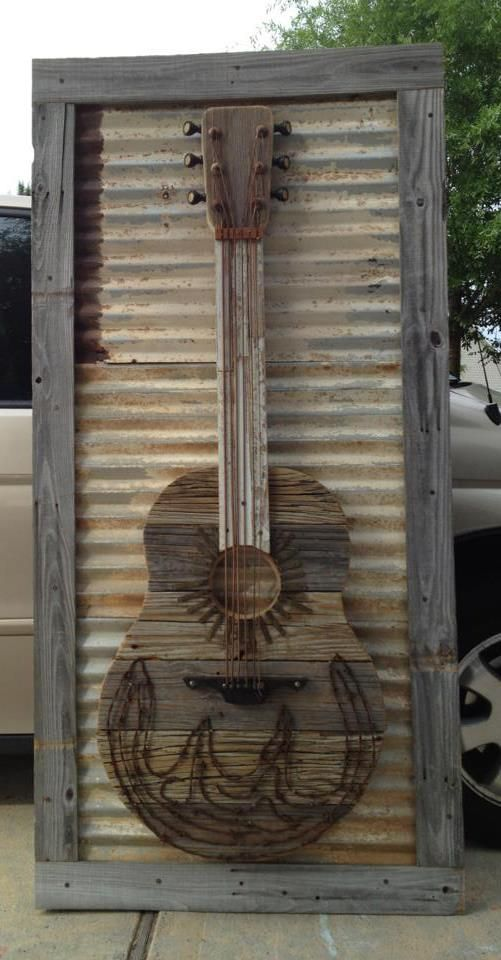 SOLD The Moore Family Folk Art guitar made from old dock wood 100 year old pianos, old roof deck, rusty barbed wire, etc.... SOLD