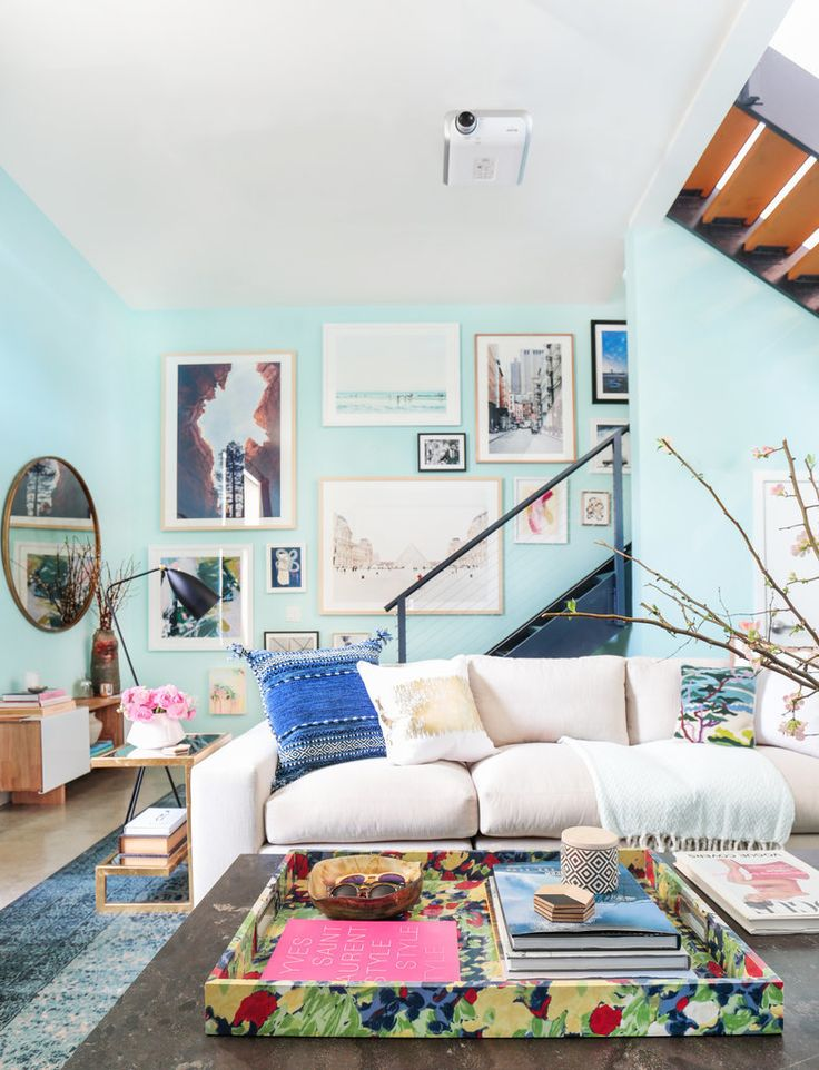 "Whitney and Tim's Venice Beach home is a work/live artist's loft complete with soaring ceilings, poured concrete floors, and stylized wire railings. ""It has an industrial feel,"" explains Whitney, who wanted Orlando to help her warm the space up."
