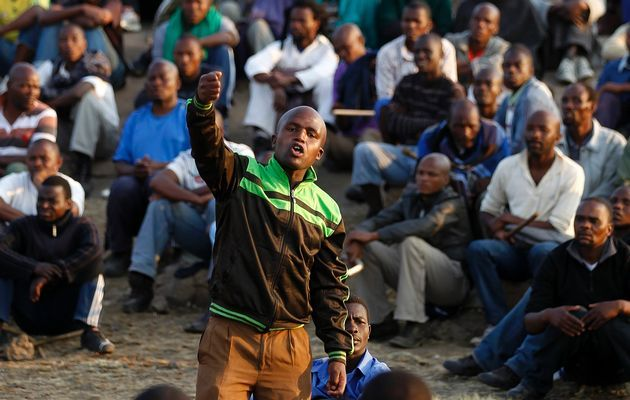 Marikana: A year on | A leader of the mine workers speaks to the miners during their sit-in. Photo: Siphiwe Sibeko, Reuters
