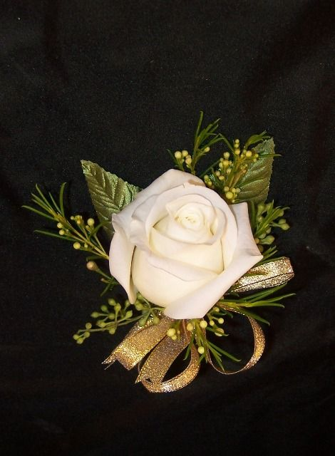 Simple white rose pin corsage with gold ribbon for a wedding sponsor. Pin corsage by Seasonal Celebrations.