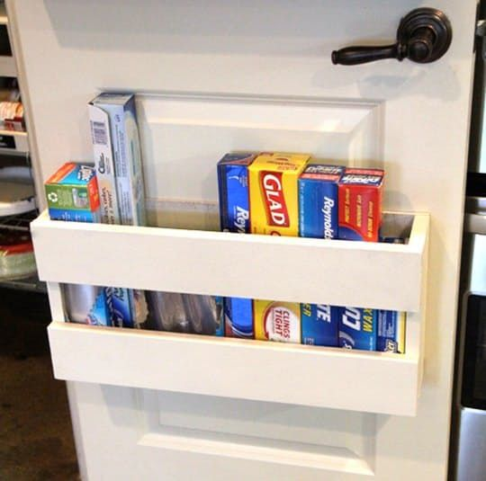 Remember this clever idea to use a magazine file for storing foil and plastic wrap? If the aesthetics of that weren't to your liking, but the door storage bit was, then this project may be just what you need. Whitney of the blog Shanty 2 Chic built her own door organizer for all her parchment, foil, and plastic wrap boxes. It cost $10 and only took her about 10 minutes, and look how sleek it looks!