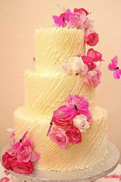 3 tier Wicked chocolate wedding cake with white chocolate ganach, spanish textured, pink roses & butterflies by Charly's Bakery, via Flickr