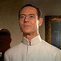"""Joseph Wiseman as Dr. Julius No. Joseph Wiseman (May 15, 1918 – October 19, 2009) was a Canadian theater and film actor, best known for starring as the titular antagonist of the first James Bond film, Dr. No, his role as Manny Weisbord on the TV series Crime Story, and his career on Broadway. He was once called """"the spookiest actor in the American theater"""""""