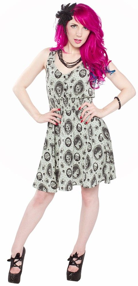 SOURPUSS ZOMBIE CAMEO DRESS Mix a little macabre with a little bit Victorian & you get the Sourpuss Zombie Cameo dress! This eerily delightful chiffon dress features a Victorian inspired pattern complete with zombie ladies & gents set in spider web frames that are surrounded by dots, skulls & spiders. The smocked waistband & flowy skirt makes it a flattering fit for all sizes! $50.00 #sourpuss #sourpussclothing #zombie #zombiedress #cameo