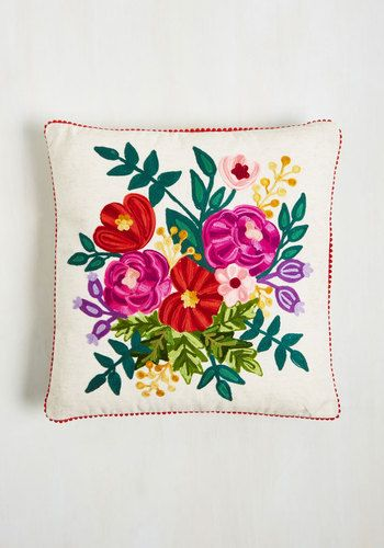 It's time for a lifestyle change - to say goodbye to hum-drum decor and to welcome in the world of embroidered pillows! Embracing its cozy cotton fabric, pink-and-purple floral pattern, and poppy red pom-poms, you're instantly hooked on this heathered pillow by Karma Living.