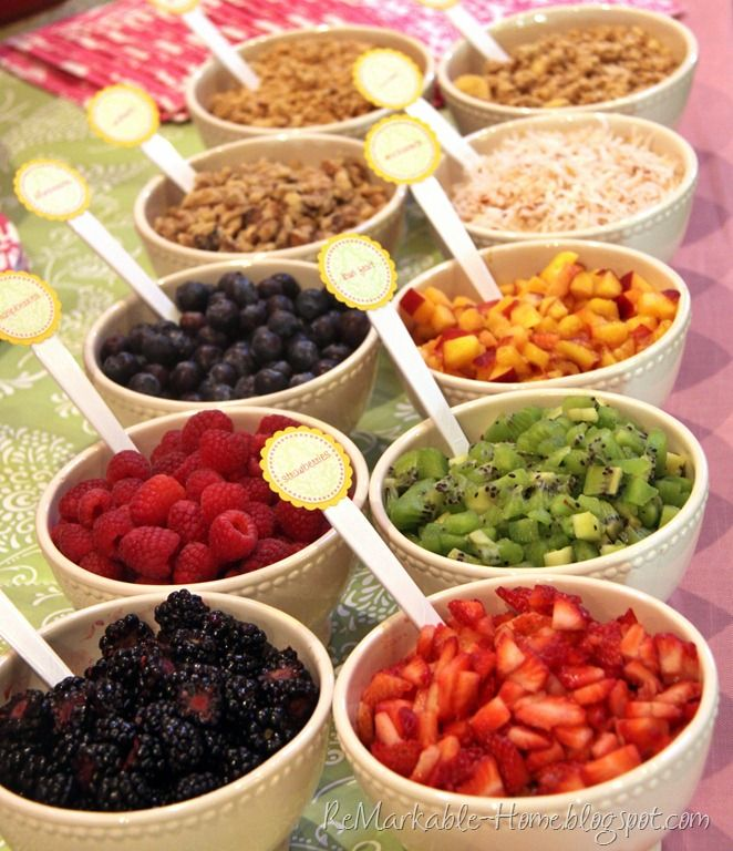a yogurt parfait bar, place several types of fruit and yogurt, as well as granola, nuts, and coconut to mix in. And jams and lemon curd to flavor the plain yogurt