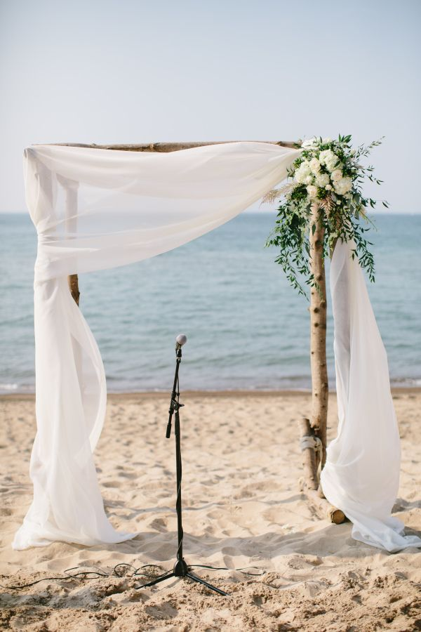 #5 pull white drapes to the left one bigger arrangement with greenery baby's breath and purple flowers white tulle