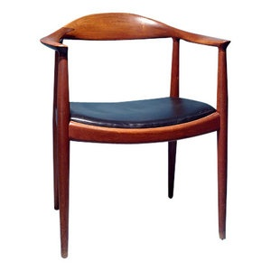 Armchair in teak and leather.  Design by Hans J Wegner and produced by Johannes Hansen.