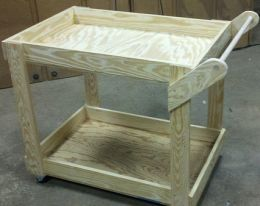 Tool Cart - Homemade tool cart constructed from plywood. Caster-mounted for enhanced mobility.
