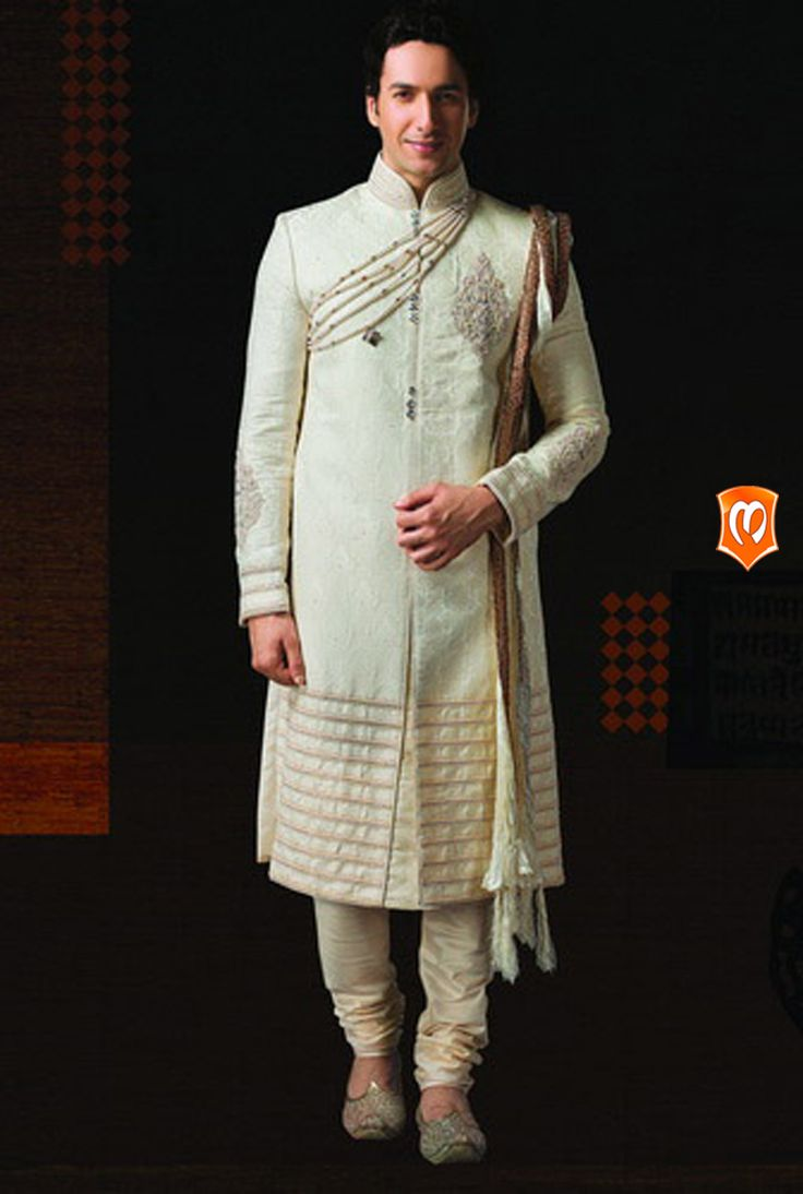 The Manyavar Royal Jaquard Sherwani :- This lurex jaquard fabric design is the a celebrated piece of our collection of wedding wear. Specific large arenas of keri designs in white sequins, and linear work at the bottom is its style with every stitch.  #Manyavar #Sherwani #Wedding #Indian Wedding Wear #Manyavar Wedding Wear #Celebration Wear #Special Occasion #Indian Ethnic Wear