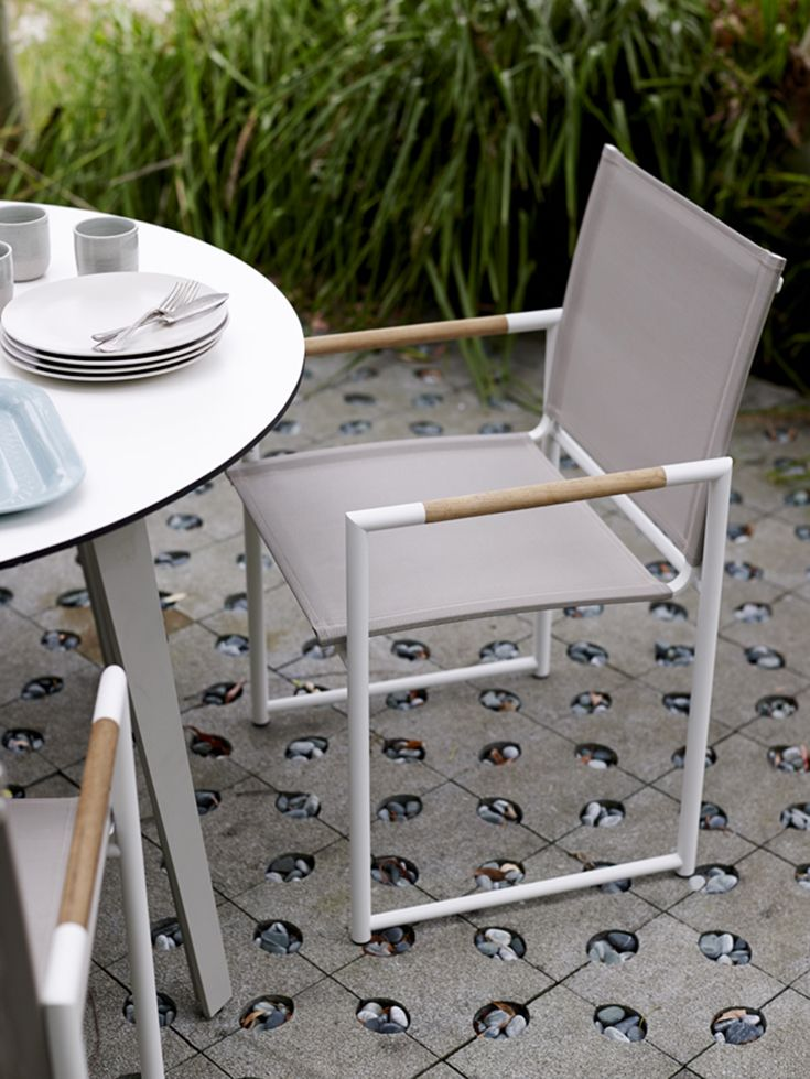 Eco Outdoor Tully dining armchair with round Aquila dining table. Outdoor furniture | livelifeoutdoors |  Patio furniture | Outdoor dining | Teak outdoor | Outdoor design | Outdoor style | Outdoor luxury | Designer outdoor furniture | Outdoor design inspiration | Pool side furniture | Outdoor ideas | Luxury homes