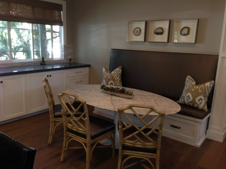 Kitchen built-in banquet with oval marble table. Perfect for breakfast or casual dining.