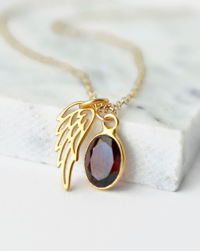 13 best miscarriage awareness jewelry images on pinterest angel miscarriage jewelry gold angel wing necklace with januarys birthstone garnet miscarriage gifts stillborn aloadofball Choice Image