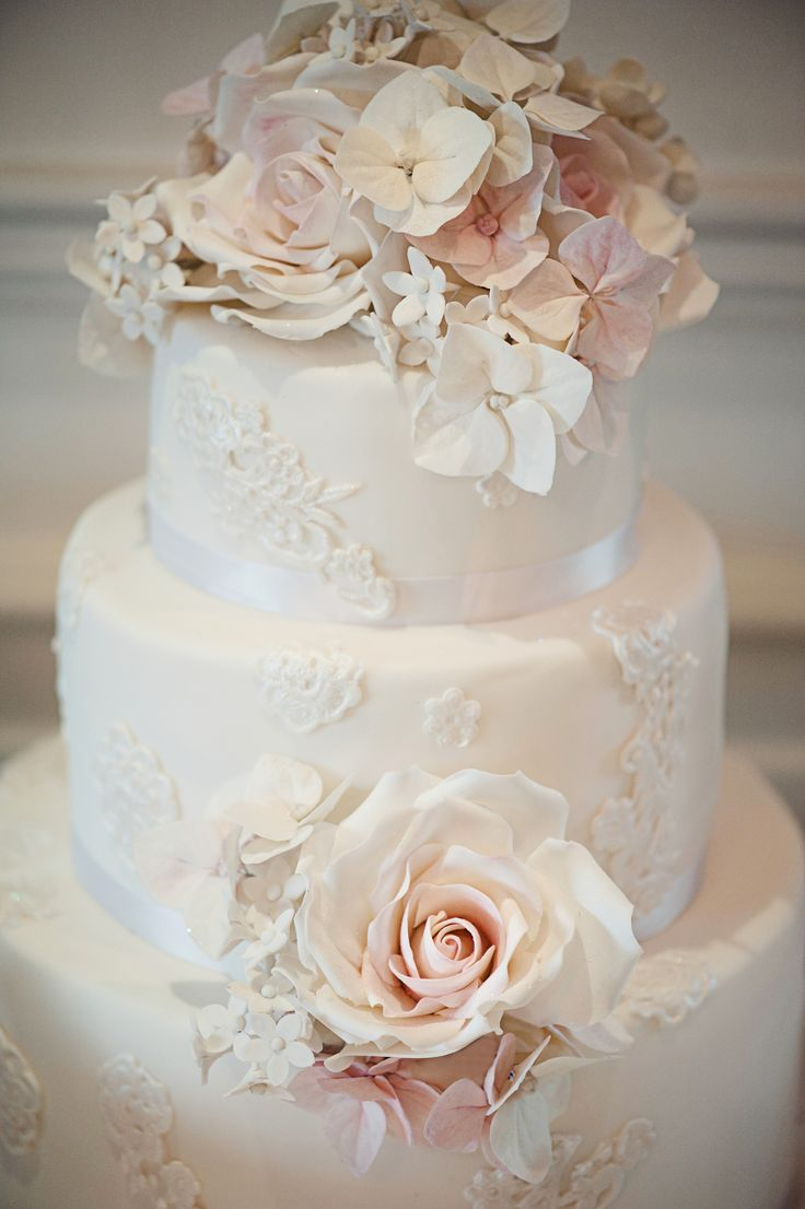 Pretty lace and rose vintage wedding cake