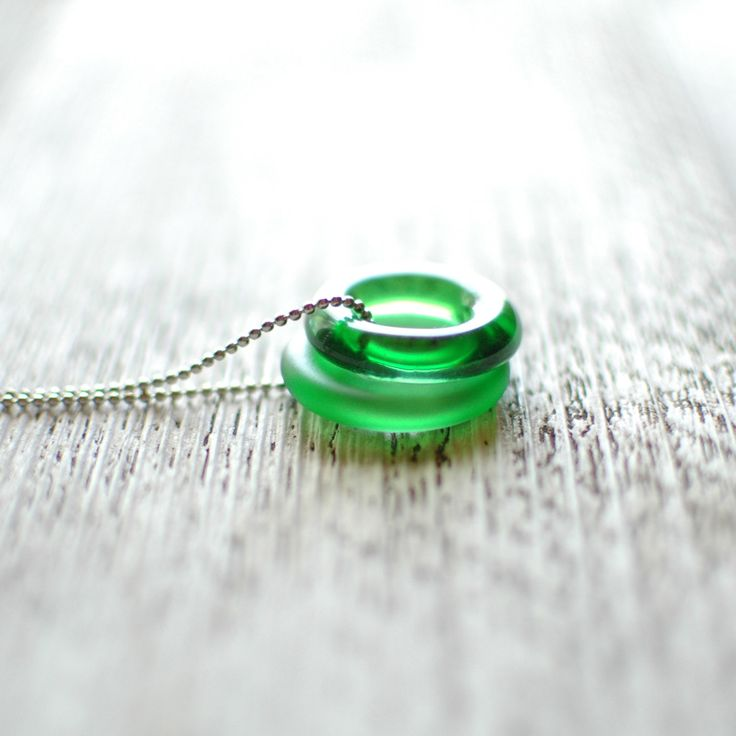 "Rescued ~ Reborn Add some green to your jewelry collection with this Jameson Duo glass necklace. Repurposed from the beautiful green Irish Whiskey bottle, these two glass beads hang loosely on a 30"" s"