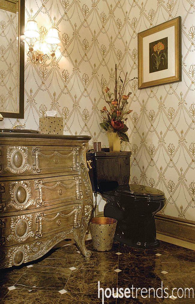 Lighting shines on a feminine powder room design