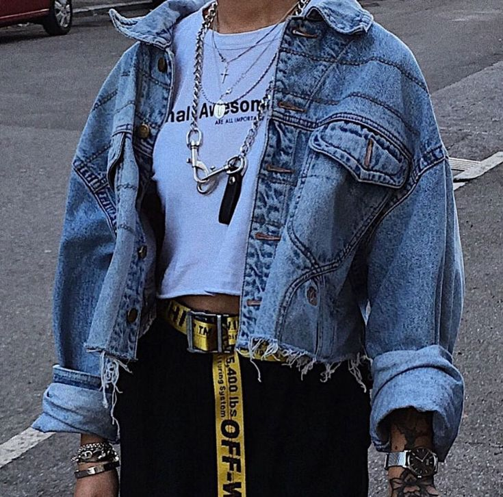 Street style outfit with denim jacket, chunky chain necklaces, off white belt an…