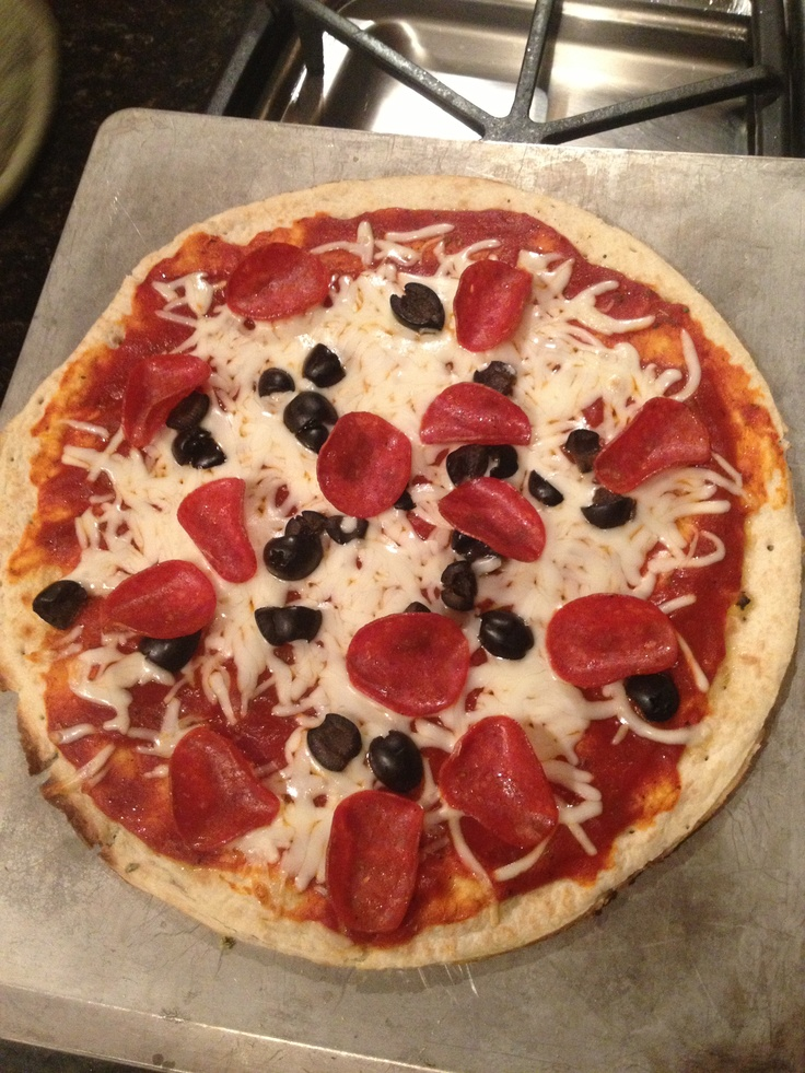 Amazing homemade pizza only being under one hundred calories! Simply go to a nearest market. Try grain free pizza crust. Any kind of pizza sauce. Veggies, onions, fruits, olives and 2% shredded cheese. Cook according to what the label tells you on the crust. Usually about 350. Cook for twenty minutes and enjoy :) no more nasty greasy delivery pizza!