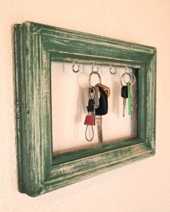 Thrift stores are great places to find slightly used picture frames of all sizes. Here's one turned into a key holder - easy, simple and you'll never lose those keys again. - MRW