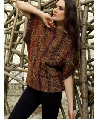 Przepiękny gruby sweter z krótkim rękawem o bardzo modnych odcieniach. Idealny na chłodne dni.