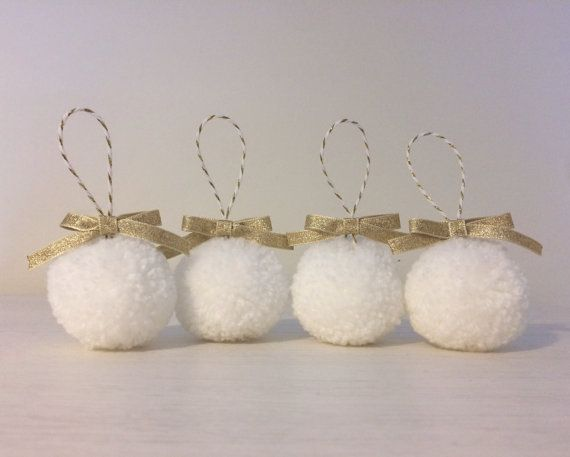 Set of 4 white and gold/silver handmade pom pom bauble decorations. Made from acrylic wool, with a gold/silver bow, on white and gold/silver twine. Each pom pom is approximately 5cm in size. They make a perfect decoration to hang anywhere around the home or as reusable party decorations.  Available to order in gold or silver. If you would like to customise the order further please specify at checkout, e.g. blue pom poms with silver bows.  Bright Island goods come beautifully wr...