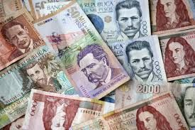 Economy : These are pecos, they are the currency in Colombia.  The minimum wage for an average colombian citizen is 644,350 pecos per month. In American money that is 225 dollars. An american salary per months is an average of 2,250 dollars. 10