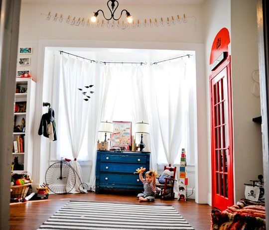 a mix of Modern and Victorian for a boys nursery. Love the antique dresser, red trim, with modern patterns