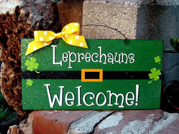 St.Patricks Day sign in green ,lime,black,yellow and white. Made of recycled wood size 6x12 inches hand crafted print. Painted back and sides