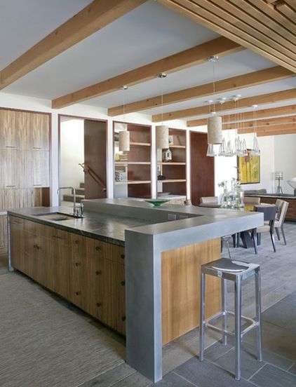 raise the back of the island to hide cooking clutter in an open kitchen. beach style kitchen by Laidlaw Schultz architects