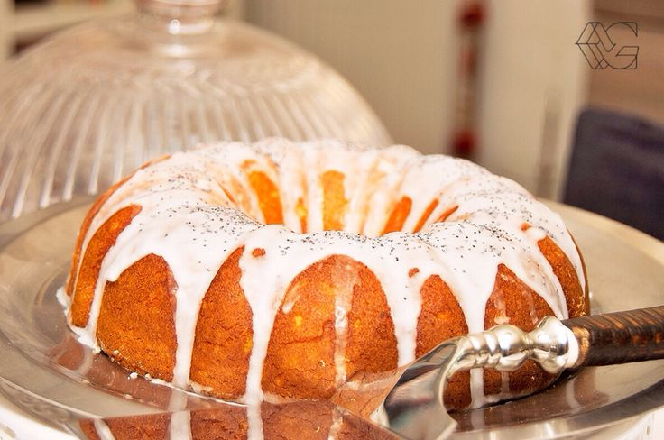 Maria's wonderful lemon sweet delight, iced and decorated with poppyseed. A must, spongy lemon cake.