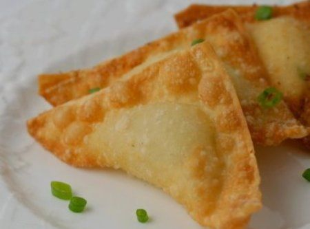 crab and cream cheese wontons with chinese hot mustard sauce.