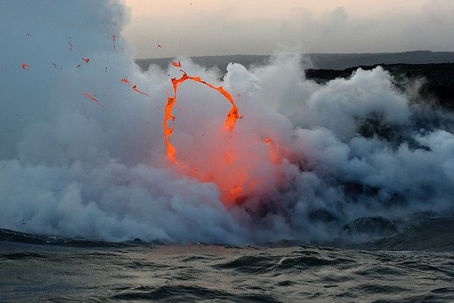 Circle of Fire  Kilauea volcano lava flow spitting into the air and ocean / Hooray for Earth - Momo album cover art by slworking2, via Flickr