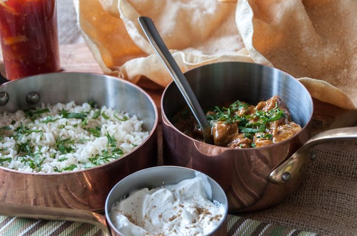 Coconut Lamb Curry. In England, curry is served with raita sauce, papadums, basmati rice and your choice of chutney.   Begin by making the curry paste. In a food processor, add the cardamom, co...