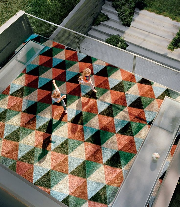 Sky, age nine, and Sylver, five, play on the graphic AstroTurf deck, designed by artist Barry McGee.  Photographed by François Halard, Vogue, May 2016.