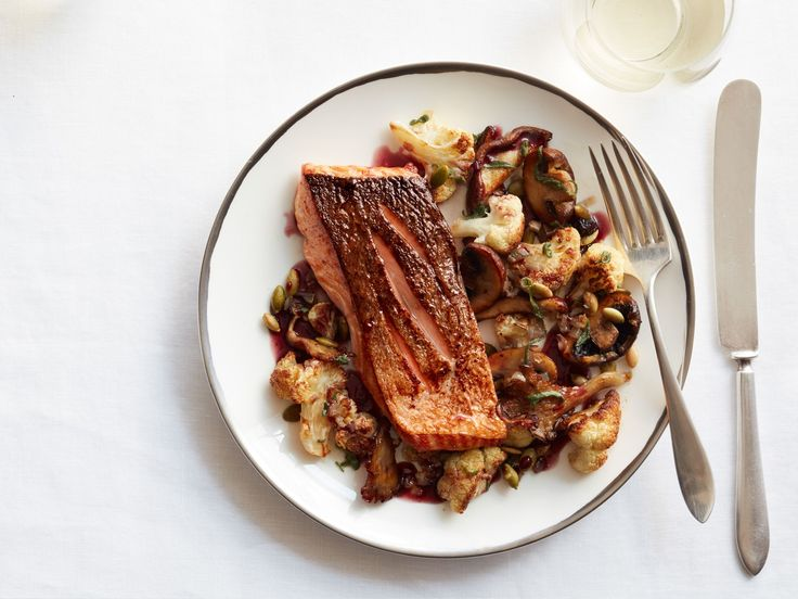 Oven-Roasted Salmon with Cauliflower and Mushrooms recipe from Curtis Stone via Food Network
