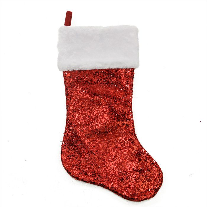 Features:  -Material: Polyester.  -Embellished.  -Decorative.  -Christmas stocking features a sheer overlay accented with shiny red holographic square sequins.  -Trimmed with a white faux fur cuff.  -