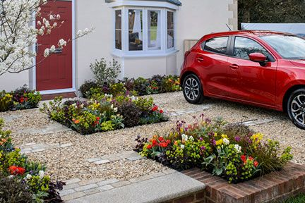 Although there is room to park, plants feature heavily in this garden. There is …