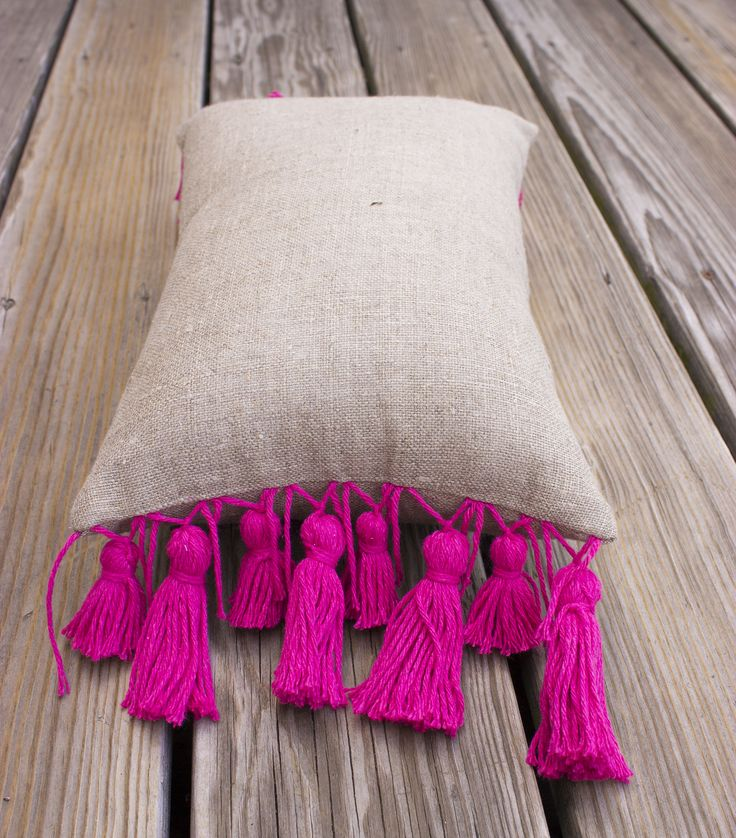 COZUMEL PILLOW HANDMADE PINK TASSELS http://www.creamcoralcollection.com/ACCENT-NATURAL-LINEN-PINK-PILLOW-p/h28015.htm