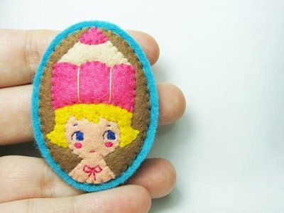 Hanako, the brooch-loving dame from Romania is back wielding her delicate needle and thread, and stitching up cushy, pinnable goodness for you to fix to your lapel.