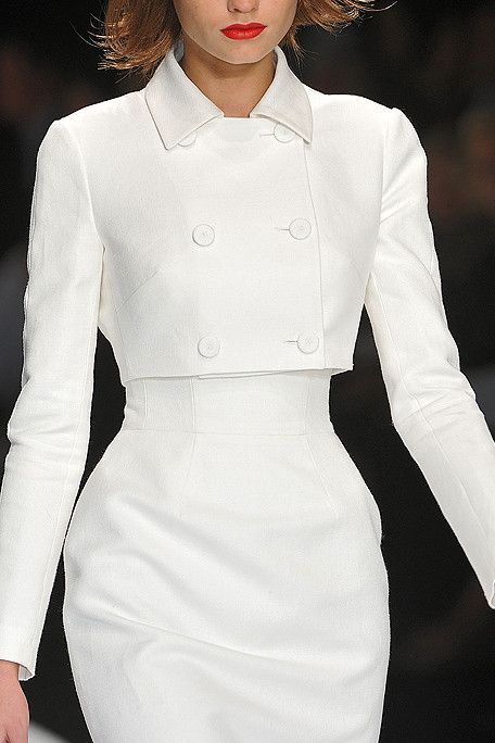 Chanel - The jacket is a wonderful piece of design; would look terrific over high waisted wool trousers.