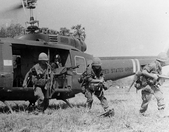 "A UH-1 helicopter lands 1st Battalion, 26th Infantry Regiment, 1st Infantry Division troop. ""Hueys"", as the helicopters were popularly known, were used for MedEvac, command and control, and air assault; to transport personnel and materiel; and as gunships in Vietnam."